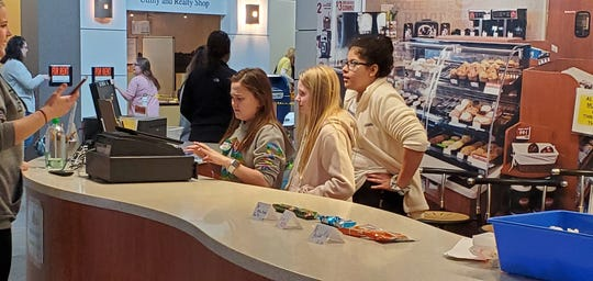Pictured here are Woodside Middle School, Saydel, sixth graders Kayton Lindman, acting as sales manager; Olivia Remington, acting as CFO, and Paola Hernandez, also acting as CFO, as they are getting the restaurant ready for customers.