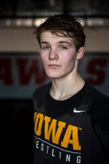 Cullan Schriever, of Mason City, poses for a photo in the Mohawk's wrestling room.