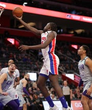 Detroit Pistons forward Sekou Doumbouya scores against the Charlotte Hornets during the second period Monday, Feb. 10, 2020 at Little Caesars Arena.