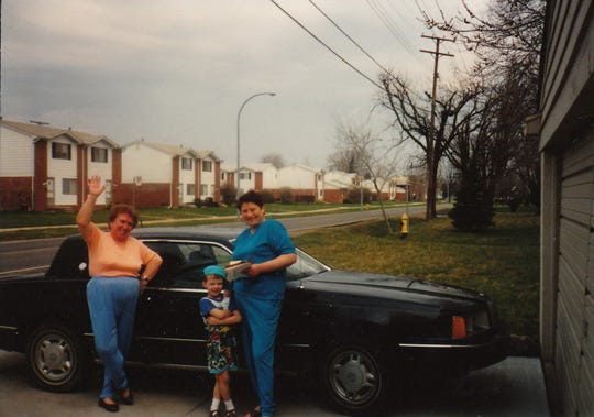 Detroit Free Press Restaurant Critic Mark Kurlyandchik as a child with both his maternal grandmother, Valentina Rinkoun, right, and his paternal grandmother, Irina Kourliandtchik, outside their Harrison Township home in the early 1990s.