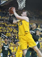 Center Jon Teske (15) and Michigan hope Saturday's victory over Michigan State serves as a springboard, much like it did in the 2016-17 season.