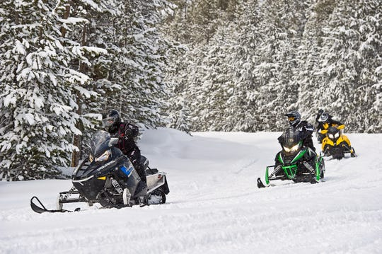 Snowmobiling on miles of groomed trails is a popular activity in and around Gaylord.