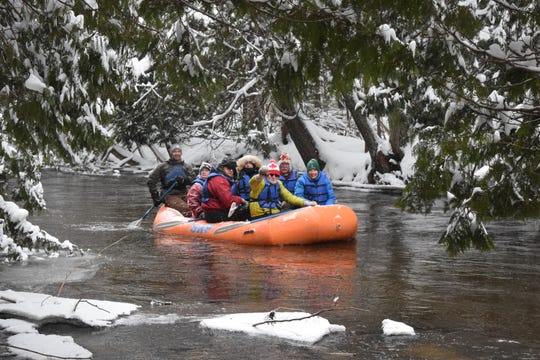 Winter rafting on the Sturgeon River near Gaylord is a peaceful pastime.