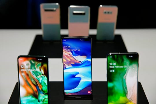 The new Samsung S10 phones are displayed in a demonstration room after an event Wednesday, Feb. 20, 2019, in San Francisco. Samsung is hailing the 10th anniversary of its first smartphone with three new models that seem unlikely to reverse a sales slump in an industry recycling the same ideas. The S10 line-up unveiled Wednesday in San Francisco all boast fancy cameras, sleek screens covering the entire front of the device and at least 128 gigabytes of storage, the most important features to consumers looking for a new smartphone.