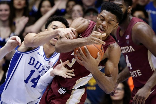 Duke guard Jordan Goldwire (14) reaches for the ball while Florida State guard Trent Forrest (3) grabs a rebound during the second half.