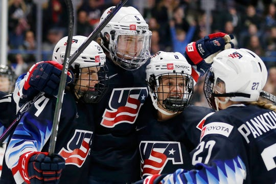United States' Megan Keller, second from left, celebrates her goal with Dani Cameranesi, from left, Emily Matheson and Annie Pankowski during the first period of a rivalry series women's hockey game against Canada in Hartford, Conn.