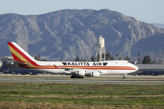 A charter flight carrying about 200 American evacuees lands at March Air Reserve Base in Riverside, Calif., on Jan. 29.