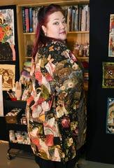 Fiber artist Laura Hatcher, of Detroit, displays a kimono in her home studio, January 7, 2020.