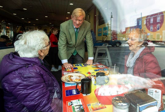 Republican presidential candidate and former Massachusetts Gov. William Weld greets guests at MaryAnn's Diner, Saturday, Jan. 25, 2020, in Derry, N.H.