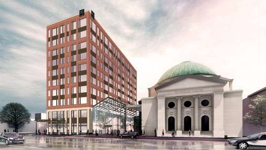 An artist rendering shows the AC Hotel to be built next to Bonstelle Theatre on Woodward.