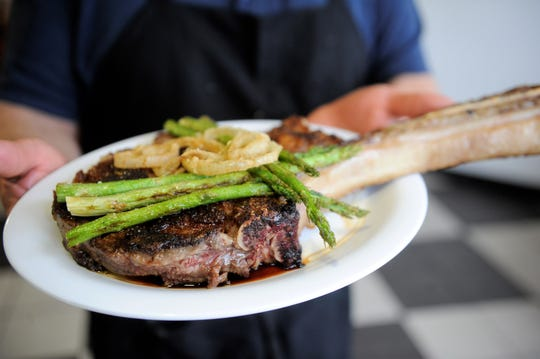 Mele's will be offering a menu of steaks such as this cowboy-cut ribeye for Valentine's day.