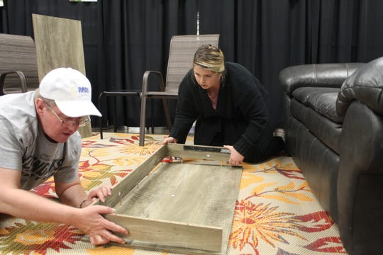NAMI staff member Ann Rusher and NAMI board member Michael Dennis put together a desk Tuesday at the organization's new Wellness Drop-In Center on Castalia Road in Fremont. The center will host a grand opening Friday from 1 to 4 p.m.