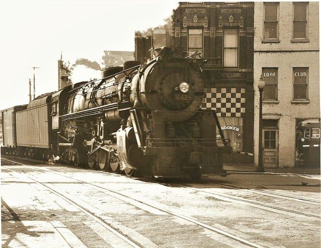 A steam locomotive heads through Fremont in the 1950s