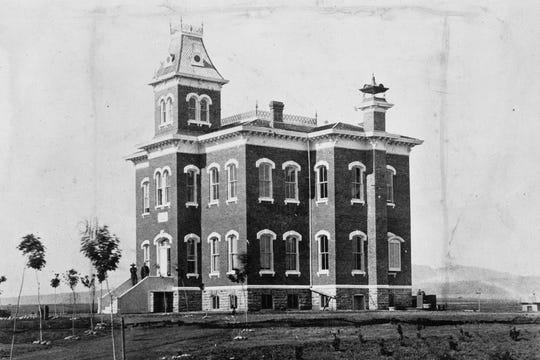 Old Main, the first permanent building on campus, was completed in 1879.