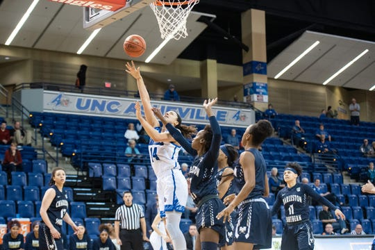 Former Riverside High star Brooke Jordan-Brown (14) has become the Big South Conference's top rebounder as a senior at UNC Asheville.