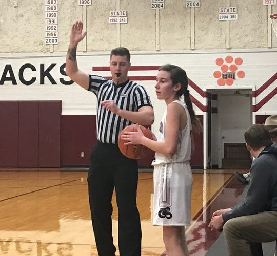 Referee Isaac Newton watches as Dutton-Brady's MacKaela Pulver prepares an inbounds pass during the D-Backs game with Power Monday night at Dutton. The game was rescheduled from Friday due to a shortage of officials.