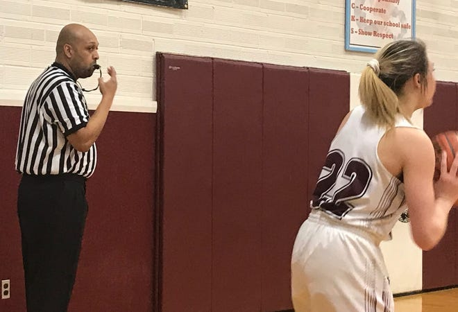 Veteran basketball official Keith Denton watches as Nadely Chapman-Roberts looks for a passing lane in Dutton-Brady's rescheduled game against Power in Dutton.