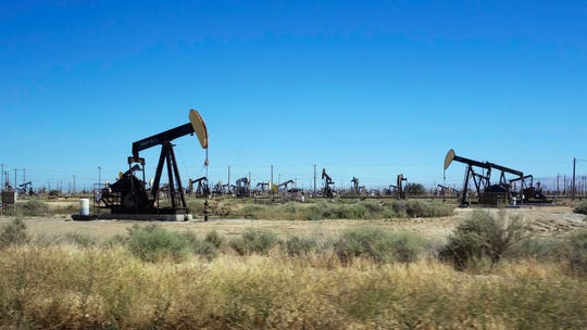 FILE - This June 12, 2017 file photo shows pumpjacks operating in the western edge of California's Central Valley northwest of Bakersfield. Oil production from federally-managed lands and waters topped a record 1 billion barrels in 2019, according to the Department of Interior on Tuesday, Feb. 11, 2020. (AP Photo/Brian Melley, File)