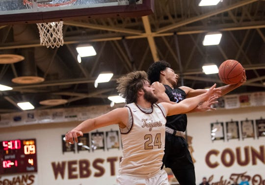 Webster County's Hunter McNaughton (24) and Union County's Kaleb Kanipe (23) battle for a rebound at Webster County High School Monday night.