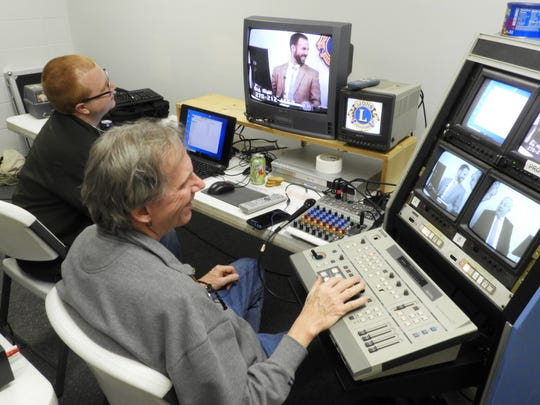 In the control room at the 2020 Henderson Lions Club Television Auction, Steve McCarty and Griffin Clary, in back, share a chuckle after longtime host Mike Smith fumbled the name of co-host Evan Dixon.