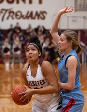 Webster County's Raigan Price (31) drives against Union County's Raelle Beaven (11) at Webster County High School Monday night.