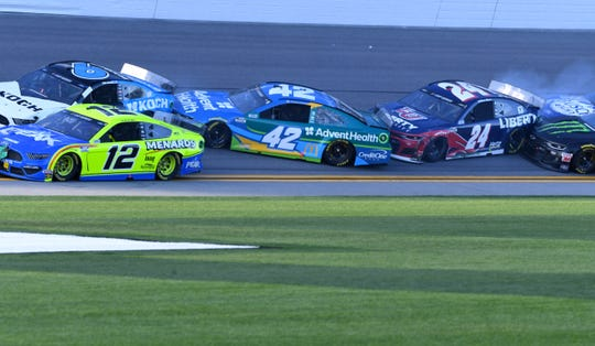 NASCAR Cup Series driver Kyle Larson (42) and driver William Byron (24) wreck Sunday during The Clash at Dayonta at Daytona International Speedway.