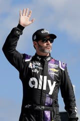 Jimmie Johnson waves to fans during introductions for the NASCAR Busch Clash auto race at Daytona International Speedway, Sunday, Feb. 9, 2020, in Daytona Beach, Fla.