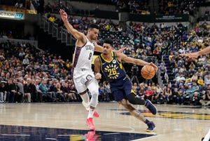 Indiana Pacers guard Jeremy Lamb (26) drives against Brooklyn Nets guard Chris Chiozza (9) during the first half of an NBA basketball game in Indianapolis, Monday, Feb. 10, 2020.