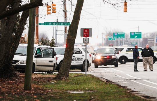 A white van sits on the curb after wrecking off of 56th Street and Brendon Forest Drive following a police chase near the northeast side of Indianapolis, Tuesday, Feb. 11, 2020. IMPD officers are investigating a shooting after a police pursuit from a shoplifting call in the 8100 Block of Pendleton Pike.