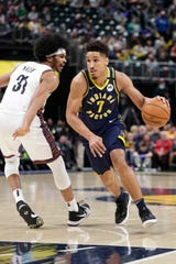 Indiana Pacers guard Malcolm Brogdon (7) drives past Brooklyn Nets center Jarrett Allen (31) during the first half of an NBA basketball game in Indianapolis, Monday, Feb. 10, 2020.