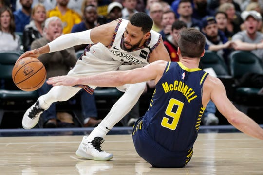 Indiana Pacers guard T.J. McConnell (9) draws the offensive foul from Brooklyn Nets guard Garrett Temple (17) during the second half of an NBA basketball game in Indianapolis, Monday, Feb. 10, 2020. The Nets defeated the Pacers 106-105.