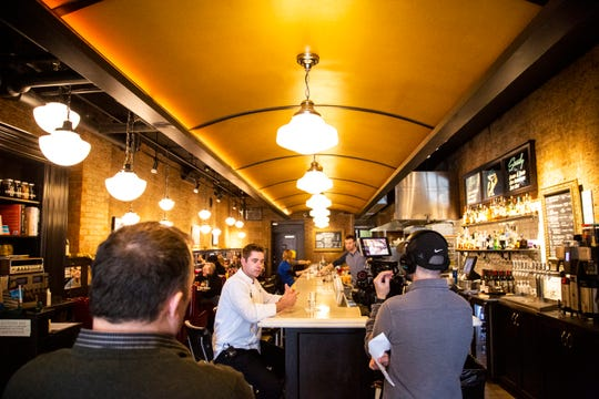 Benjamin Smart, executive chef of Big Grove Brewery, Pullman Bar & Diner, and St. Burch, does an interview for a promotional video, Tuesday, Feb. 11, 2020, at the Pullman Bar & Diner, Iowa.
