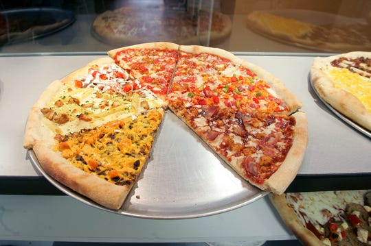 A variety of different pizza slices are on display at the Mesa restaurant in downtown Iowa City on Friday, March 20, 2009. The restaurant features pizza by the slice, ranging in flavors from Pepperoni-Salami to Avocado Delight.