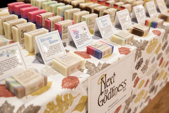 Soaps from Next to Godliness sit on a table during a winter market at Carnahan Hall, Tuesday, Feb. 11, 2020 Lafayette.