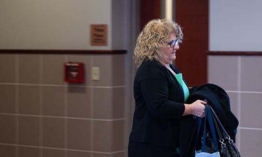 Former Michigan State University womens gymnastics coach Kathie Klages arrives at Veterans Memorial Courthouse in Lansing, Mich., Tuesday, Feb. 11, 2020, where she'll face a jury trial on two counts of lying to police during a 2018 interview.