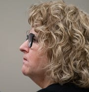 Former Michigan State University womens gymnastics coach Kathie Klages listens to testimony Tuesday, Feb. 11, 2020, at Veterans Memorial Courthouse in Lansing, Mich., where she's on trial for two counts of lying to police during a 2018 interview. Klages denies that two gymnasts told her in 1997 that Larry Nassar, a former MSU sports medicine doctor who abused hundreds of girls and young women under the guise of medical treatment, had sexually abused them.  [AP Photo/Matthew Dae Smith/Lansing State Journal]