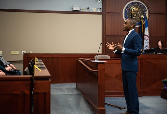 Klages attorney Takura Nyamfukudza addresses the jury during opening statements Tuesday morning, Feb. 11, 2020, in Ingham County Circuit Court Judge Joyce Draganchuk's courtroom at Veterans Memorial Courthouse in Lansing, Mich.  Klages is on trial for two counts of lying to police during a 2018 interview.