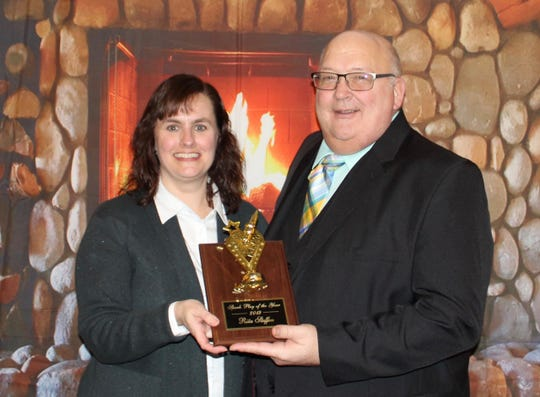Rita Steffen receives the Spark Plug Award from Clipper City Chordsmen President David Rabe.
