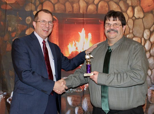 Keith Duprey (right) receives the Clipper City Chordsmen Rookie of the Year Award from Don Lewellen.