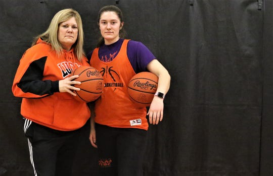 Lucas senior Paige Arnold (right) and her mother, Lucas junior varsity coach Jackie Arnold, had visions of leading the Lady Cubs to a conference title since Paige was a youngster.
