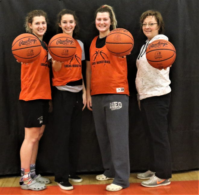 The Grover sisters, (left to right) junior Jamie, freshman Shelby, and senior Jessie, along with their mother, head coach Kathy Grover, helped the Lady Cubs to a historic season on the basketball court.