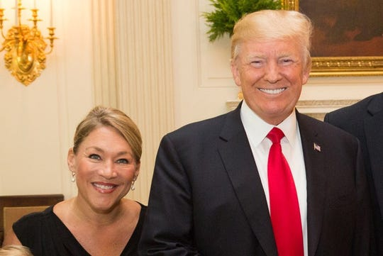 This is part of a photograph of Ohio Senate candidate Melissa Ackison, left, and President Donald J. Trump, right, that Ackison is using on her campaign website and other advertising materials. Ackison received a letter last week from Trump campaign CEO Michael Glassner demanding that she stop using the photograph, which is her personal property. Ackison said she will continue to use it and others that were taken during a 2017 visit to the White House.