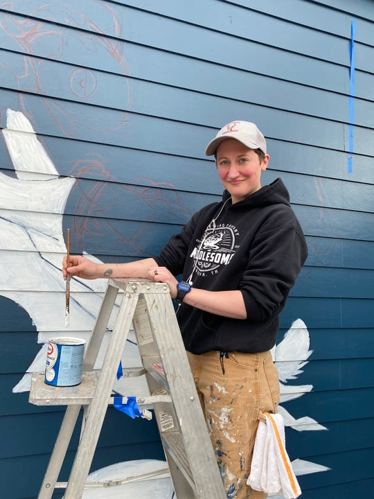 Emily LaForce, a sous-chef at River Oaks, paints murals at restaurants on her days off.