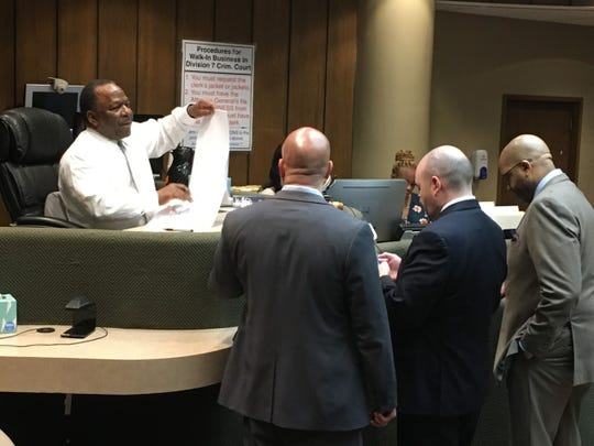 Criminal Court Judge Lee Coffee (seated) discusses trial dates with lawyers involved in the Billy Turner case on Tuesday, Feb. 11, 2020. Moments after this huddle, the judge announced that Turner's trial is now scheduled to take place Oct. 26.