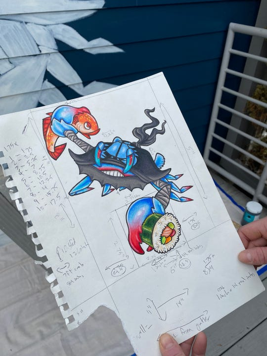 As part of her mural painting process, Emily LaForce creates a sketch and uses it to calculate the dimensions that will fit on the wall.