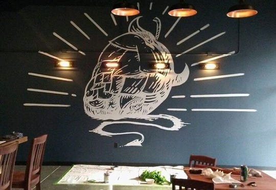 Memphis chef Emily LaForce painted the mural at the Meddlesome Brewing Company taproom.