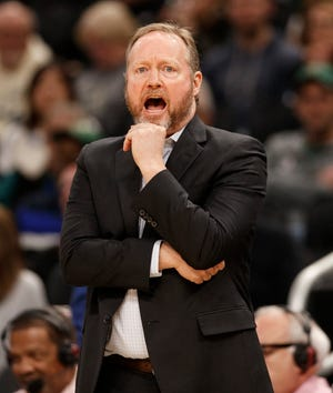Bucks head coach Mike Budenholzer barks out instructions to his team during the third quarter as it takes on the Kings.