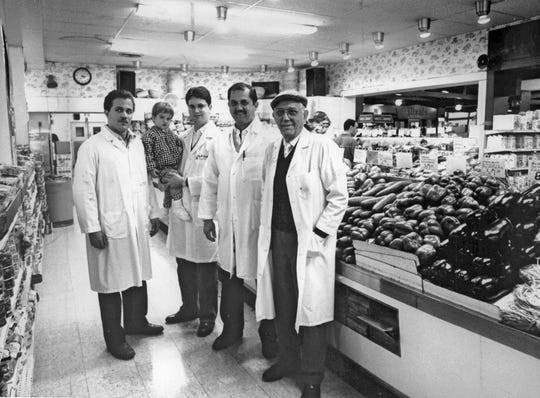 Salvatore Sendik, second from right, is seen in a 1988 Milwaukee Journal photo with his family inside the Downer Avenue Sendik's market. From left, he is joined by his son John, grandson Anthony III, son Anthony Junior, and father Anthony Senior.