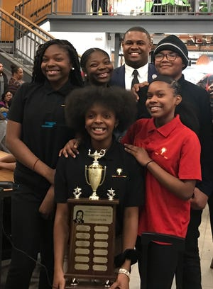 Students from the Milwaukee College Prep School's Lola Rowe North campus celebrate their win in the 4th Annual Black History Trivia Bowl.