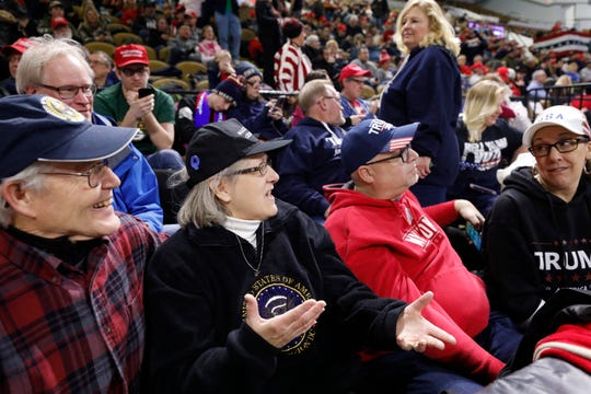 Randy Jacobson (left) and Diane Jacobson speak to other Trump supporters before  a campaign rally for President Donald Trump on Jan. 14, 2020, in Milwaukee.